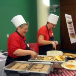Dean Rooks and Assoc Dean Bruxvoort serve pancakes