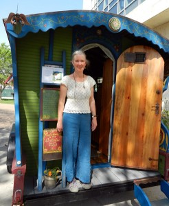 Donna Thomas at the door of the gypsy wagon