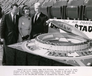 County Judge Bill Elliot, Mrs. Elliot, and R. E. Smith, Chairman of the Board, Houston Sports Association looking at a model of the world's first domed, air-conditioned stadium--future home of the Colt .45s.