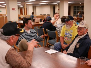 Fred Hekking, Special Collections student worker Bryan Bishop, Jerry Ranger, and Bill Ingram