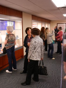 Members of USS Houston Survivors Association and Next Generations view exhibit