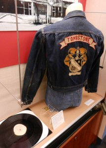 "From the exhibit:  Shellac-coated metal record (sent to radio stations as promotional materials for Frontier Fiesta in its heyday) and ""Tombstone"" jacket"