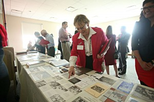 Bauer alumni and guests enjoying artifacts from the University Archives