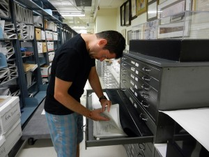 Student worker Bryan Bishop working in the stacks