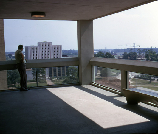Agnes Arnold Hall, open corridor at upper level, c. 1972. In background PGH and Hilton Hotel are under construction. (Photo Kenneth E. Bentsen Architectural Papers)