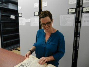 At work in the stacks.  We welcome Sara Craig to the University of Houston Special Collections, University Archives team.