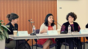 Lisa Cruces (center), Archivists for the Hispanic Collections, addresses a question from the audience during the panel discussion
