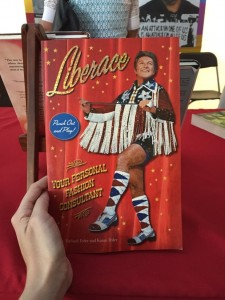 Edward Lukasek's copy of Liberace: Your Personal Fashion Consultant, a book of Liberace paper dolls emblazoned with life mottos, was a crowd-pleasing favorite.