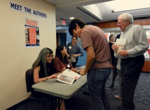 Attendees of the exhibit's opening were able to meet with authors and discuss their research.