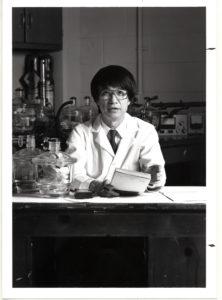 Paul Chu sitting at a lab desk.