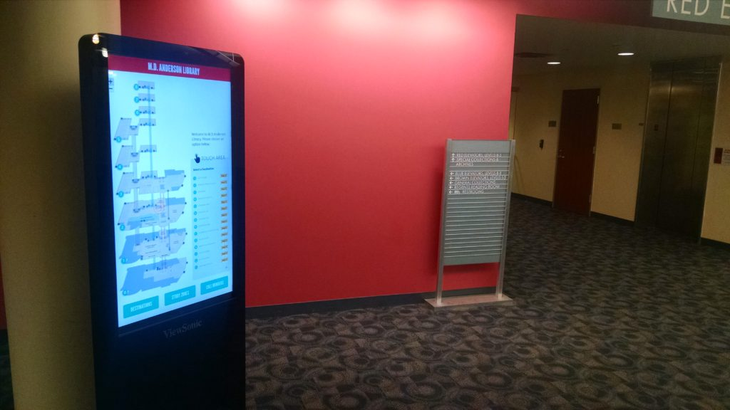 A photo of the digital sign seen in 2nd floor Red Wing, just outside the Red Elevators and Special Collections.